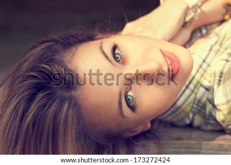 Close-up Portrait of Lying Beautiful Woman Looking at the Camera - stock photo