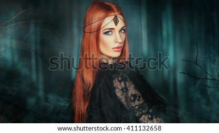Close up portrait of magnificent Fashion gothic girl .Fantasy art work.Amazing red haired model in black dress and head wear looking at camera and dreaming.Fairy tale about young princess  - stock photo