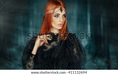 Close up portrait of magnificent Fashion gothic girl .Fantasy art work.Amazing red haired model in black dress and head wear looking afar and dreaming.Fairy tale about young princess - stock photo
