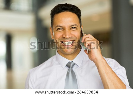 close up portrait of male corporate worker talking on cell phone - stock photo