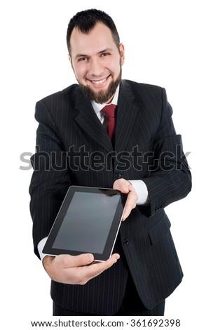Close-up portrait of man holding digital tablet - stock photo