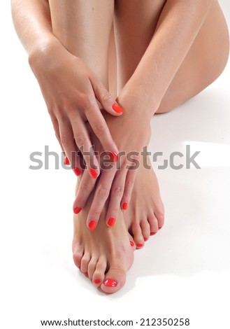 Close-up portrait of manicured nails and pedicured toes  - stock photo