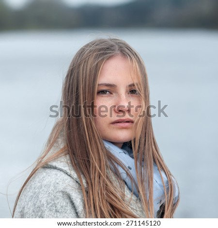 Close-up portrait of natural beauty girl with freckles and clean skin - stock photo