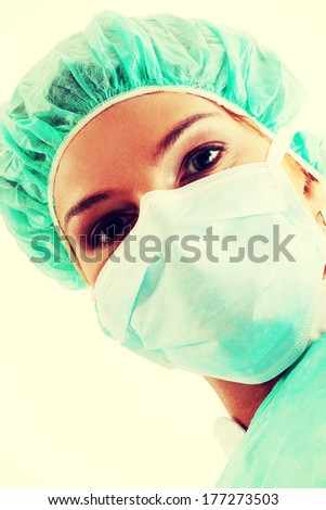 Close-up portrait of nurse or doctor in surgical mask