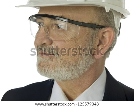 Close up portrait of old architect against white background