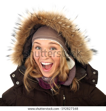 Close up portrait of one happy frozen  woman in winter coat  isolated background - stock photo