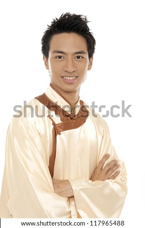 Close up portrait of Oriental chinese young man with tradition clothing - stock photo