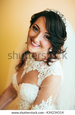 Close up portrait of pretty bride in hotel room