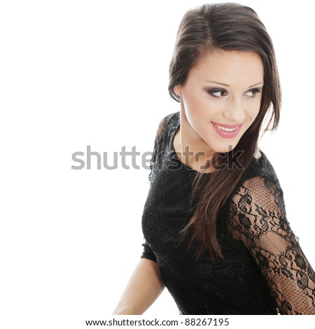 Close up portrait of pretty brunette woman wearing black sexy dress, isolated on white background