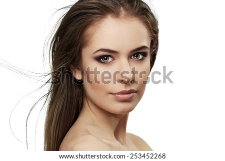 Close-up portrait of pretty brunette woman with long straight hair isolated over white background. Young lovely female with professional makeup posing in studio.   - stock photo