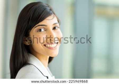close up portrait of pretty indian office worker - stock photo