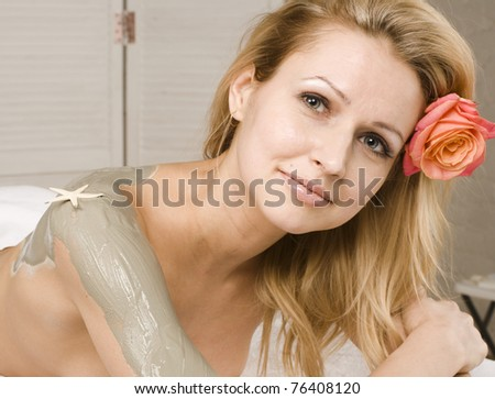 close up portrait of pretty sexy woman with flower