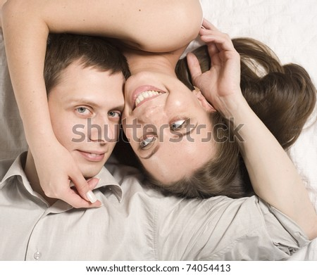 close up portrait of pretty young couple. man and woman hugging