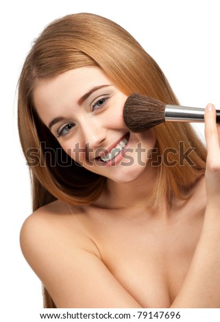 Close-up portrait of pretty young woman with brush for makeup, isolated on white - stock photo