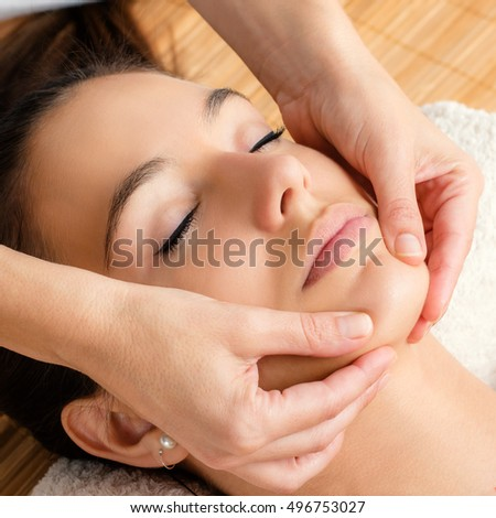 Close up portrait of Relaxing facial massage on female chin.