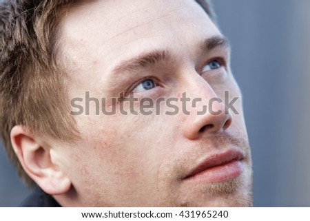 Close up portrait of romantic charismatic blonde man