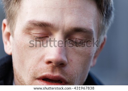 Close up portrait of romantic charismatic blonde man. pensive. looking down - stock photo