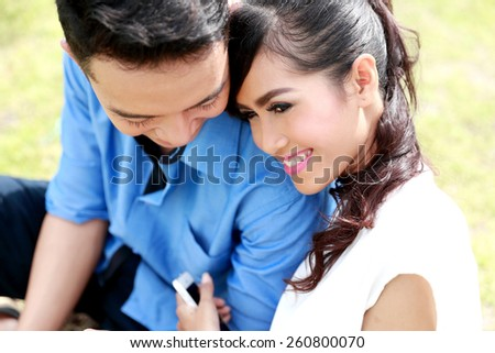 close up portrait of romantic young couple happy together - stock photo