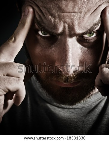 Close-up portrait of scary man looking very stressed and upset - stock photo