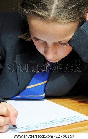 close-up portrait of school girl at desk - stock photo