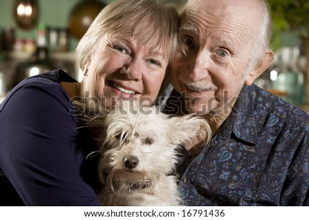 Close Up Portrait of Senior Couple with Dog - stock photo