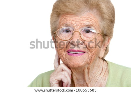 Close up portrait of senior woman with hand on ear.Isolated on white.