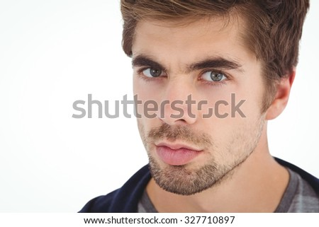 Close-up portrait of serious man against white background