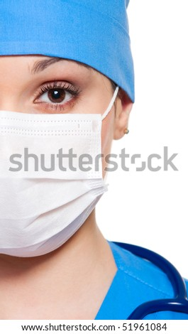 close-up portrait of serious nurse in white mask