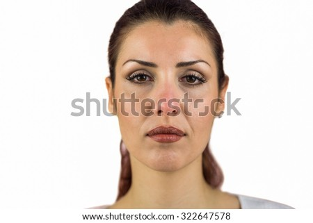 Close-up portrait of serious woman against white background - stock photo