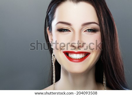 Close-up portrait of sexy caucasian young model with glamour red lips make-up. Perfect clean skin. Ukrainian woman purity face with bright lips makeup - stock photo