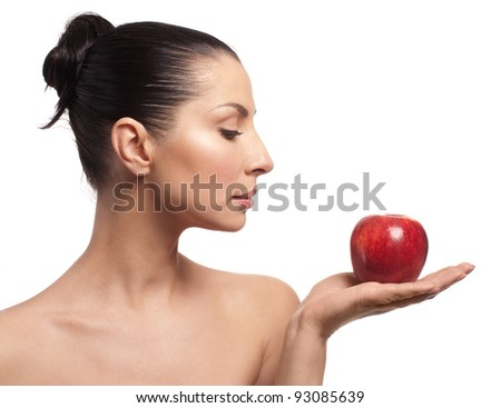 Close-up portrait of sexy caucasian young woman with apple
