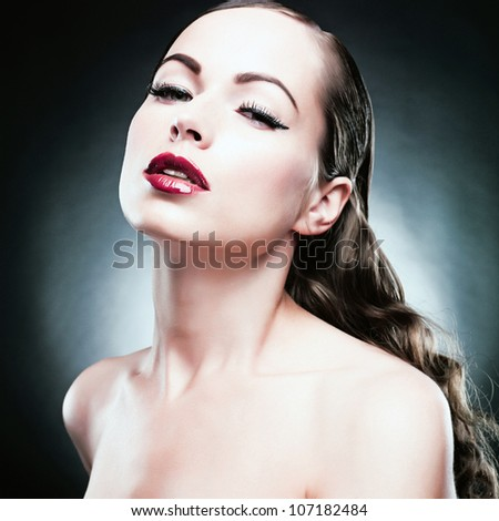 Close-up portrait of sexy caucasian young woman with beautiful eyes and sensual lips - stock photo