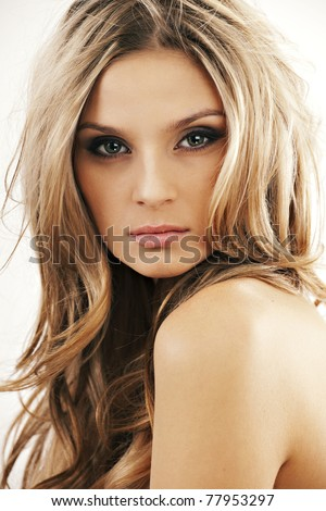 Close-up portrait of sexy caucasian young woman with beautiful green eyes - stock photo