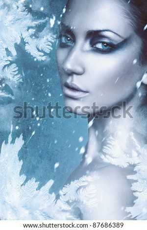 close up portrait of sexy winter woman in snow