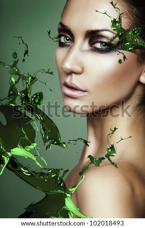 close up portrait of sexy woman in green plant splash