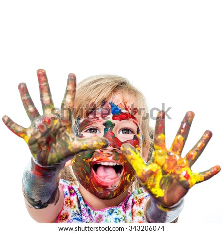 Close up portrait of shouting Little Girl messed with color paint.Infant showing hands covered with paint. Isolated on white background.
