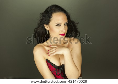 Close up portrait of smiley beautiful woman with hair motion shoot in studio, isolated on a grey background