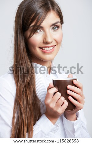 Close up Portrait of smiling business woman, isolated on gray background with coffee cup. - stock photo