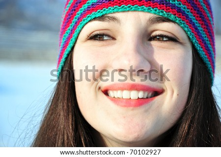 close up portrait of smiling girl outdoors in winter time