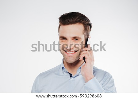 Close up portrait of Smiling Man in shirt which talking on the phone and looking at camera. Isolated white background