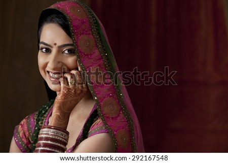 Close-up portrait of smiling young bride