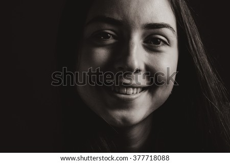 Close up portrait of smiling young woman. Retro. Sepia