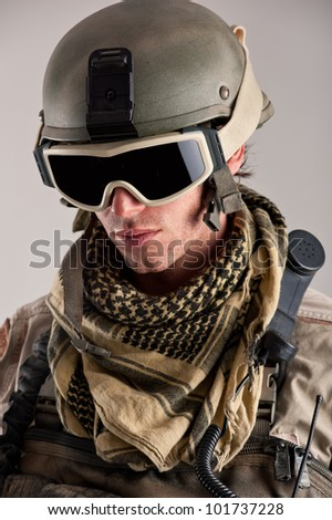 Close up portrait of soldier with mask and helmet. - stock photo