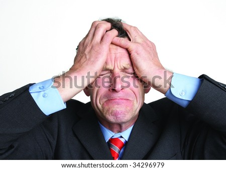 close up portrait of stressed out businessman - stock photo