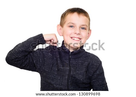 Close up portrait of strong smiling boy showing muscles. Isolate - stock photo