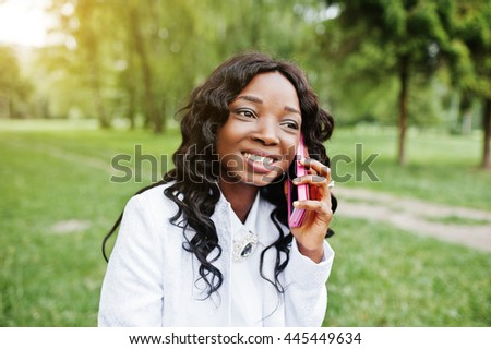 Close up portrait of stylish black african american girl with pink mobile phone - stock photo