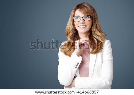 Close-up portrait of successful businesswoman standing at isolated background.