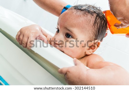 Close up portrait of sweet baby boy in the bathtub