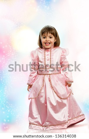 Close up portrait of sweet girl in princess dress. - stock photo