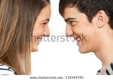 Close up portrait of teen couple facing each other.Isolated - stock photo